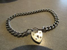 Sterling silver ladies curb bracelet with heart lock