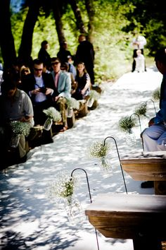 Aisle lined with baby's breath in mason jars.