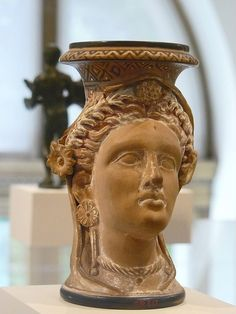 Terracotta oinochoe (jug) in the form of a woman's head Etruscan late 4th century BCE