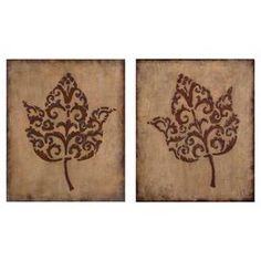 """Set of two raised-leaf wall plaques with a beige stucco finish and burnished edges.  Product: 2 Piece wall art setConstruction Material: MDF and mirrored glassColor: Antiqued beige and chocolateDimensions: 24"""" H x 20"""" W x 1.25"""" D each"""