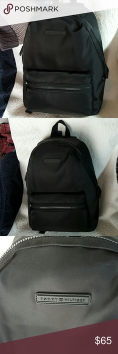 Roomy backpack This backpack features top zip closure, exterior zip pocket at front, brand logo detail. Lined interior one slip pocket, one long compartment for tablet, mini laptop or important documents.  Solid black nice solid inner logo.  Made of nylon. Imported.  Measurements Middle Width: 16 in Depth:: 5 in Height: 16 in Strap Length: 34 in Strap Drop:  14 1/2 in Handle Length: 71/2 in Handle Drop: 3 in Weight: 1lb 22 oz. Tommy Hilfiger Bags Backpacks
