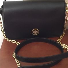 """Tory Burch """"Robinson"""" Black Leather mini bag NWT This beautiful mini bag is crafted in black Saffiano Leather with all gold hardware. Inside is fully lined TB jacquard material with 1 main interior zip pocket. The front flap magnetic snap closure is secure and strong. On the back of the bag is a long slip pocket. Comes with dust cover. Approximate Measurements: 9""""L X 5-1/2"""" H X 2"""" D. Strap: 22"""" drop Tory Burch Bags Crossbody Bags"""