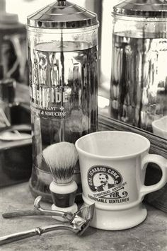 The Classic Barber Shop. Barbacide & a shaving mug.