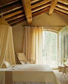 Wonderful, functional window treatments; the ceiling beams aren't bad either.