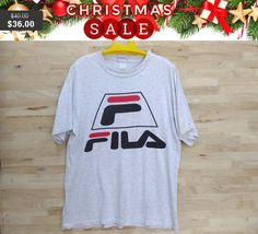 Christmas Sale Vintage 90's Fila Big Spell Out Big Logo Men Woman Clothing Nice and Good Fabric Large  Made In USA T-Shirt by ArenaVintage