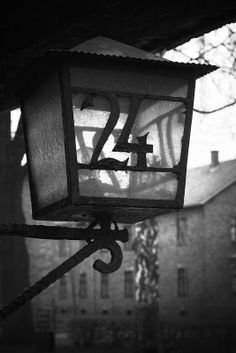 Block 24 lamp (Block 24 today houses the Archive of the Auschwitz Memorial). In the background Block 15.