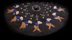 a dizzying maze of moving cubes, an endlessly walking character with a cane, and squirming sequence of worms have each been embroidered onto disks and played on a standard turntable.