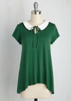 Looks like you've found that perfect top that makes you feel completely carefree! This forest green blouse - with its white Peter Pan collar, tied keyhole, flowing high-low hem, and ultra-soft jersey knit - provides class and comfort, guaranteeing a spot with your favorite staples.