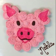 Cupcake Cake for a special little Piggy named Nahla.  This has over 30 individually iced cupcakes.