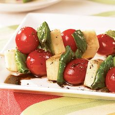 Caprese Skewers....tomatoes, fresh mozz, basil, and olive oil......so easy!