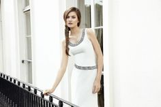 Sea Foam Evening Gown: Sea foam colour round neck silk crepe evening gown with intricate antique silver interwoven hand embroidery at neck and across waist diagonally. Slit at lower front centre.  http://www.zaeemjamalboutique.com/dresses/sea-foam-gown.html