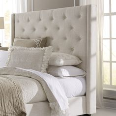 Features:  -Construction Material: Manufactured wood frame with solid rubberwood legs, foam padding and polyester upholstery.  -Headboard only, side rails and footboard not included.  -Please be aware
