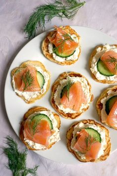 Smoked Salmon Blini Canapés, the perfect party food for your New Year's Eve. Delicious blinis topped with silky cream, cucumber, smoked salmon and a touch of lemon; can't think of a better appetizer! Wine Party Appetizers, Party Canapes, Cocktail Party Food, Wine Tasting Party, Appetizers For Party, Parties Food, Food Tasting, Smoked Salmon Canapes, Healthy Recipes