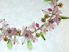 """'Quiet Morning Necklace' by K for """"Trifles & Whimsy"""" on Etsy. Vintage Lucite Flower, Swarovski and Czech Crystals, Freshwater Pearls, and Czech Pressed Glass leaves"""