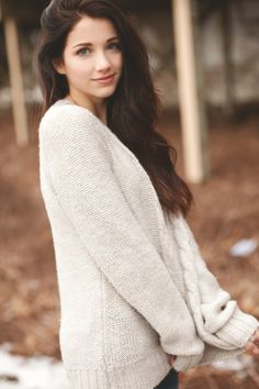 Over-sized sweater and a soft smile
