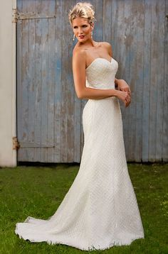 H7953:Strapless fishtail gown with sweetheart neckline. Beaded criss-cross lace overlay revealing floral lace underlay.  Colours Available:Ivory