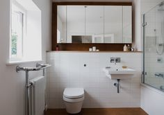 Love the built in shelf and floating mirror • creative way to fit in wall hung toilet   Well Street,© Mariell Lind Hansen