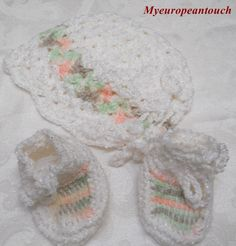 I just listed White with multi pastel colored Baby cap/hat and matching booties, hand crochet on The CraftStar @TheCraftStar #uniquegifts