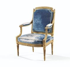 A CARVED GILTWOOD ARMCHAIR, LOUIS XVI