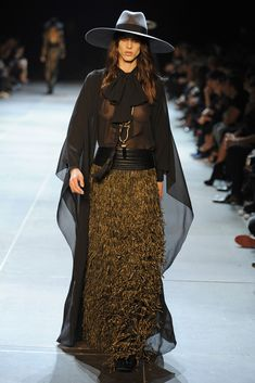 When she looks like a corn-field-crow...who gives a damn about the nipples? Bad styling at Saint Laurent RTW Spring 2013
