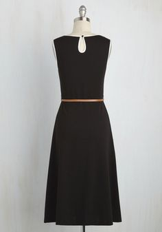 As a professional genealogist, your style is inspired by many eras on a day-to-day basis. Show up to the office tomorrow wearing this black dress, which boasts white satin piping that's 60s-mod and a draping midi length that's 70s-chic. With a thin, brown vegan faux-leather belt that matches your record books, and a cute keyhole closure opposite its fitted princess seams, this drop-pocketed frock couldn't be more perfect for your job. Pair it with ivory pumps that your clients will jus...