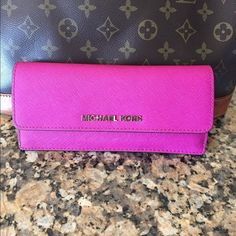 (SOLD) Authentic MK Saffiano pink wallet Beautiful MK Saffiano pink wallet its super cute!  In very good conditions!!! Michael Kors Bags Wallets
