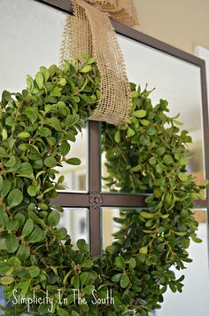 17 DIY Holiday Decorations | A lovely Boxwood wreath is such a Southern touch. Beautiful simplicity. ~
