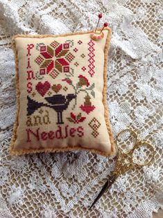 Hand stitched Pins and Needles pin cushion with black crow