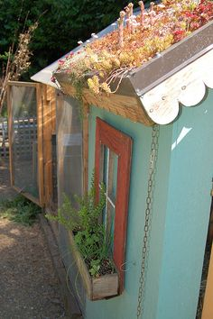 Ingela Wanerstrand's chicken coop, my favorite for its green roof, thoughtful design, rain barrels and little window box.