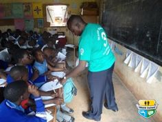 Mr. Ddungu introducing the WASH United 'WASH in Schools' programme to trainees in Kasubi Family Primary School in Kampala, Uganda.