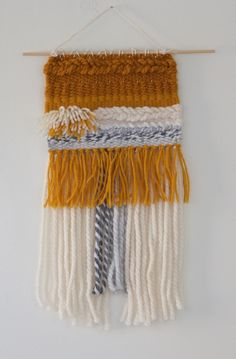 Wall hanging hand woven by forLincoln. This gold, ivory, and grey beauty will brighten up, and add character to your home. Made with bulky and thin yarns in the San Francisco Bay Area, California. - G