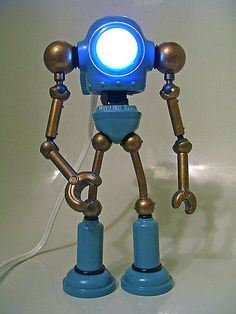 Mike 'M. Heisler' Slobot makes awesome retro-looking robots out of old toys, scrap materials, and found objects.
