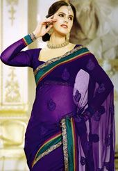 Dark violet faux chiffon saree designed with resham, zari and patch border work. Available with matching blouse, blouse shown in the image is just for photography purpose. (Slight variation in color is possible. )