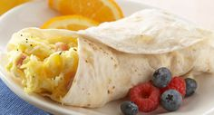 For those times when your family needs breakfast on the run, prepare these hand-held scrambled eggs, ham and cheese burritos.