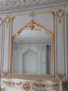 Gold leaf Boiserie over mantel, part of hand carved Boiserie living room. Designed & manufactured by Auffrance.