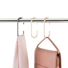 Let's get hitched! People who love their scarves, belts and bags will love the Hitch Clip Accessory Organizer by Umbra. Made of metal, it hooks perfectly over your closet rod or any other hook, to hold and organize your accessories - all without taking up much room in your closet.