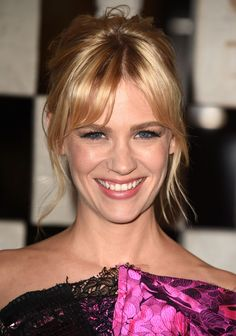 January Jones makes a perky updo and center-parted bangs look grown-up and chic.