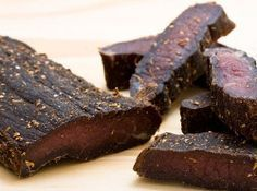 Biltong is an all-time favorite South African snack. This biltong recipe will let you experience what the fuss is all about.It might be a little work to make biltong, but it is well worth the effor. Read Recipe by mrydms A Food, Good Food, Food And Drink, Charcuterie, Jerky Recipes, Meat Recipes, Tagine Recipes, Chicken Recipes, Making Jerky