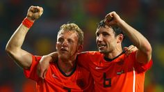 Dirk Kuyt (L) of the Netherlands celebrates with team mate Mark Van Bommel after victory and progress to the semi-finals during the 2010 FIFA World Cup South Africa Quarter Final match between Netherlands and Brazil at Nelson Mandela Bay Stadium on July 2, 2010 in Nelson Mandela Bay/Port Elizabeth, South Africa.