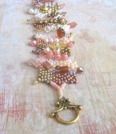 mauve freeform beaded bracelet by beadnurse on Etsy,