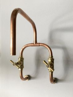 This handmade wall-mount mixer tap is the perfect touch for your industrial/steampunk/vintage interiors and fits both bathroom and kitchen, residential or commercial spaces. Its made of 15x1mm copper pipe and bronze fittings perfectly welded and sealed. The stop valves are high quality forged brass. Tested and fully functional. For technical details see the attached data sheet in photos section. Measurements • Width: 180mm • Depth: 305mm • Height: 295mm • Pipe Diameter: 15mm • Dimen...