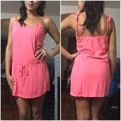 Pink Swim Cover-Up Pink/Salmon Beach cover up. Very comfortable. Straps tie at each shoulder to adjust height of dress. Middle has a drawstring. Small pocket over left breast. Size large. Also works for someone who wears a medium. Xhilaration Swim Coverups