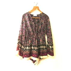 Purple patterned romper Cute multicolor boho style romper with tie front. Size small. Worn once. Audrey Pants Jumpsuits & Rompers