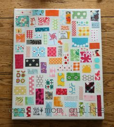 Take scraps of fabric and mod podge them on to canvas. Love this idea for a kid's room or a sewing room, obviously :)