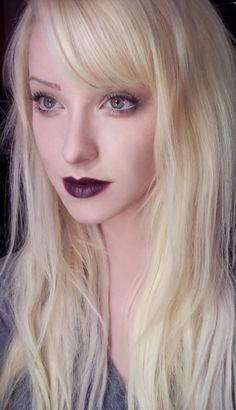 A fresh take on the 90s - dark lips, subtle smoky eyes and platinum blonde hair.