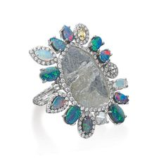 Nina Runsdorf white gold slice diamond ring with diamond and opal.