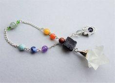 Click now to purchase!   Crystal Pendulum Clear Quartz Merkaba Pendulum Black Tourmaline 7 Seven Chakra Stone Hamsa Hand Divining Dowsing Metaphysical Spiritual Tool by MariposaStoneWorks on Etsy, $39