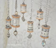 Necklaces made from vintage wooden spools and sheet music  I'D MAKE CHRISTMAS ORNAMENTS.  :)