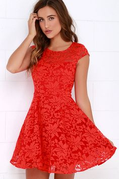 When high fashion comes a-knockin' in the form of the Some Like It Haute Coral Red Jacquard Skater Dress, you're going to want to answer the door! Swirling floral jacquard atop sheer organza fabric flows from a semi-sheer, sweetheart decolletage and cap sleeves into a large back keyhole with top button closure. Darted bodice flows into a pleated fit-and-flare design with full skirt. Hidden back zipper with clasp. Dress is lined. 70% Cotton, 30% Nylon. Hand Wash Cold.