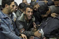 A Palestinian man cries next the body of a dead relative in the morgue of Shifa Hospital in Gaza City, Sunday, Nov. President Barack Obama on Sunday defended Israel Israel Gaza, Israel News, Morgue Photos, Feeling Thankful, Gaza Strip, Crying Man, World Press, News Around The World, Popular News